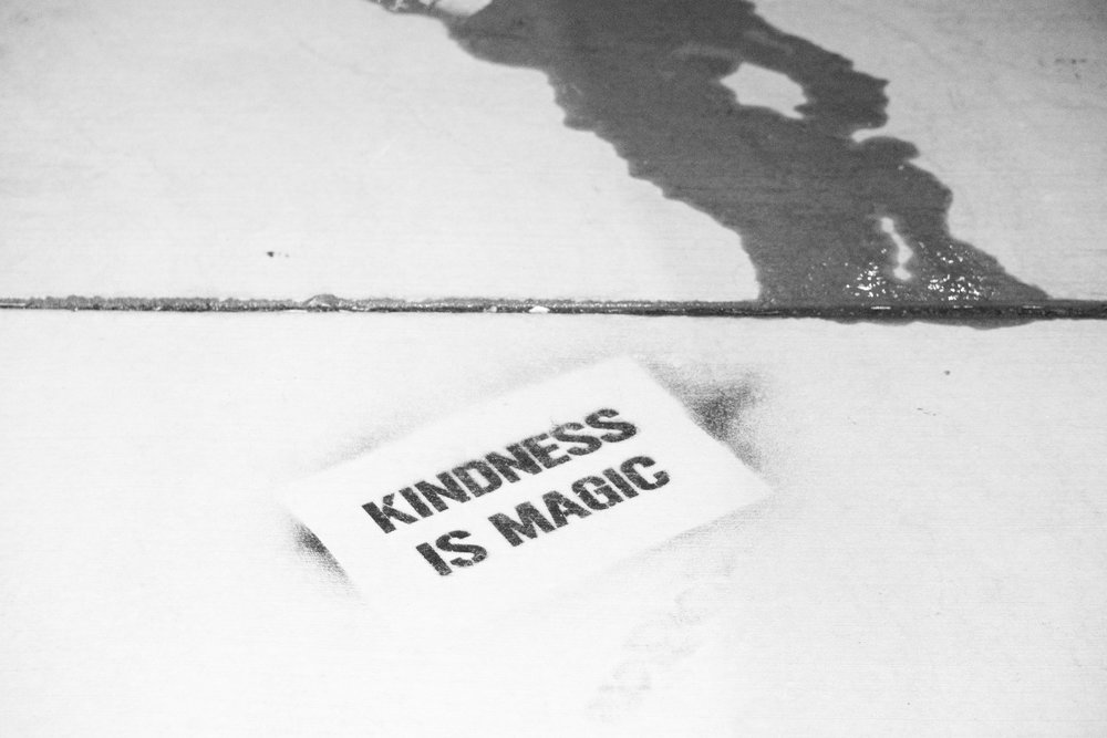 "A piece of paper that says ""kindness is magic."""