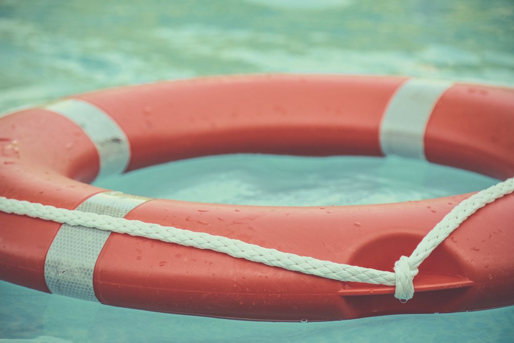 A life preserver floating in a pool to save a victim.