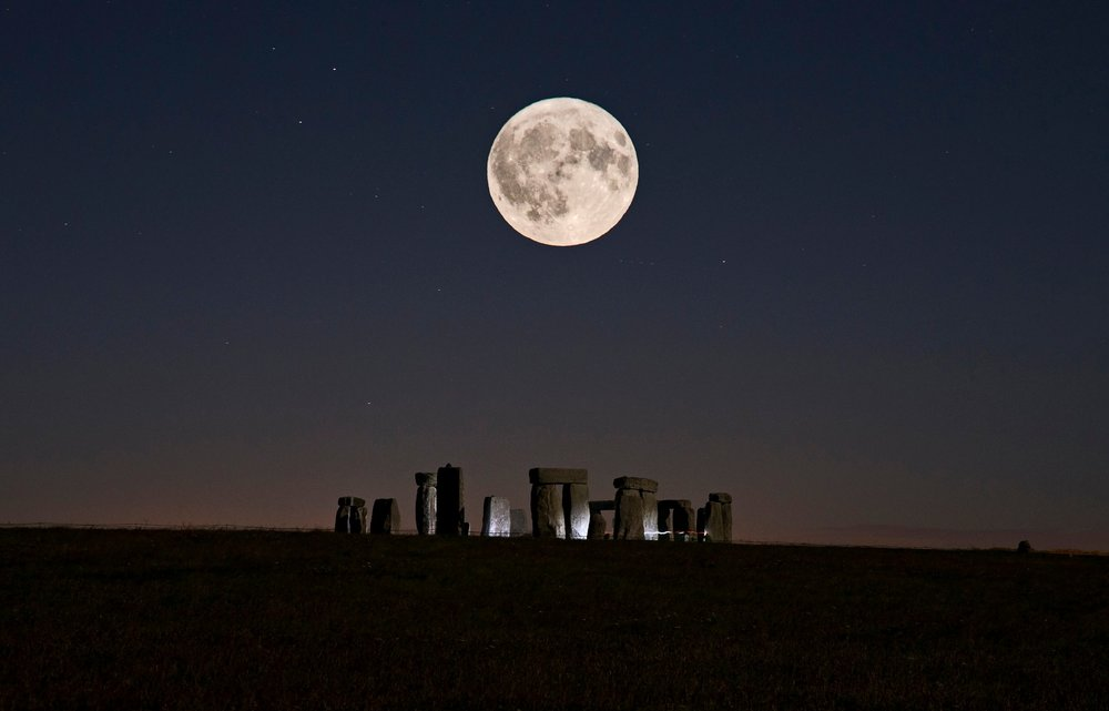 A double exposure image of the Harvest Full Moon over Stonehenge 2018.