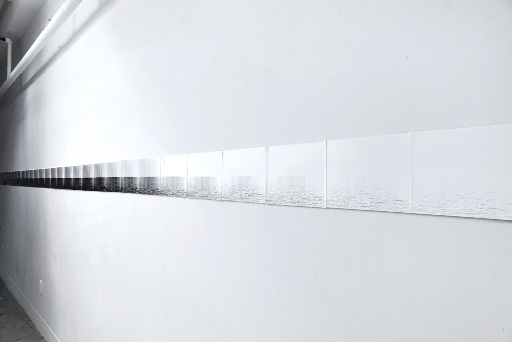 "Installation view  Gradual Withdrawal of an Ocean , series of 8""x10"" silver gelatin photographs where each strip is an increasingly longer exposure until the white paper reveals an image and finally becomes black. 2013"