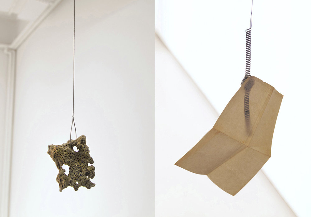 Writing the Hours , a fragment of coral/ petrified sand is suspended by the weight of my father's broken aeronautical watch and stamped letter from Easter Island. Steel cable, sand, father's watch and letter. 2013. collaboration with Carlos Vela Prado