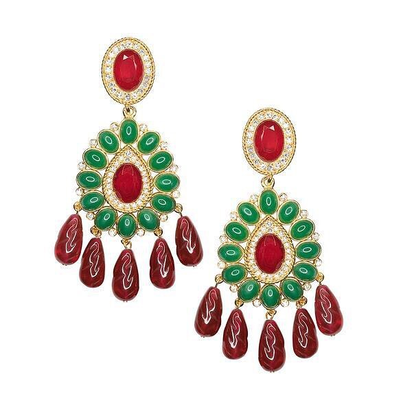 Jewelry, although synonymous with precious stones and metal, can be made from a variety of materials. During the nineteen-sixties, the American costume jewelry designer Kenneth Jay Lane began to quickly redefine how fashionable women viewed jewelry. And soon, magazine editors were pairing faux gems by Lane with designer dresses.  These earrings are also a copy of ones owned by Diana Vreeland, which were sold at an auction of her jewelry.  Image: Ruby and Emerald drop clip earrings. Image courtesy of Kenneth Jay Lane (@kennethjaylane)