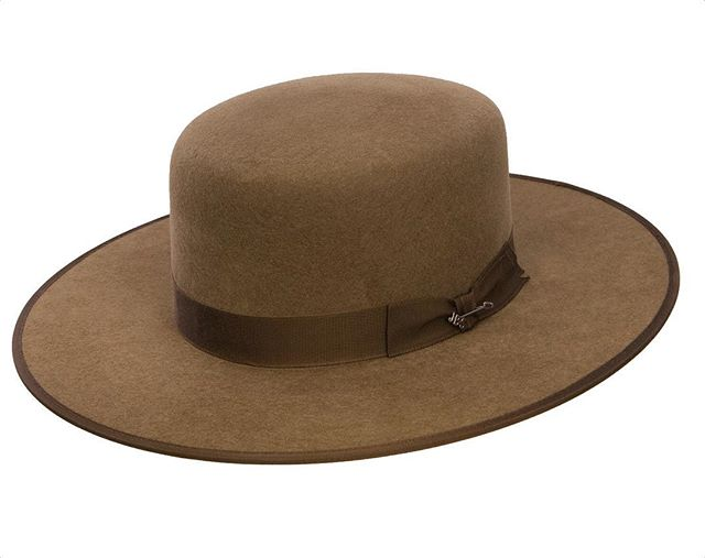 """""""The concept of authenticity is ingrained into the American West. But while the region's evolving urban landscape has at times struggled to maintain its sense of validity, Stetson has succeeded in preserving its estimable reputation. In 1865, John B. Stetson invented the original cowboy hat, which was later marketed by the company as the Boss of the Plains. The hat's wide brim and open crown, which were constructed out of waterproof fur felt, were a direct response to the region's harsh environment. Westerners, from a variety of classes and occupations, adopted the functional accessory and the iconic design became synonymous with the area. The hat became so popular that cheap imitations made of wool were sold in catalogs in an attempt to capitalize on Stetson's success.  This modern Stetson Austral hat is marketed as a """"replica of the original hat that John Stetson himself made."""" With a wide brim and open crown, the hat certainly resembles the original Boss of the Plains, however it is made of wool felt rather than fur."""" - Marisa Lujan (@marisa_lujan)  Image: Stetson Austral hat. Image courtesy of Stetson Worldwide (@stetsonusa)"""