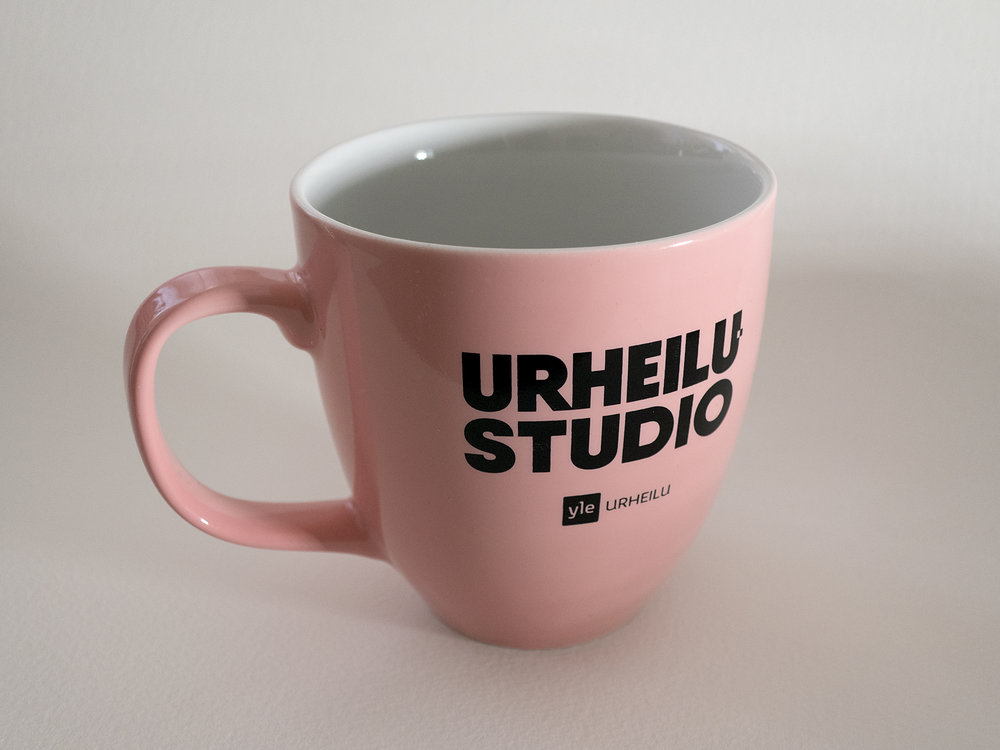 Branding for Yle Urheilustudio. A glossy mug designed to be used in the studio by hosts and guests.