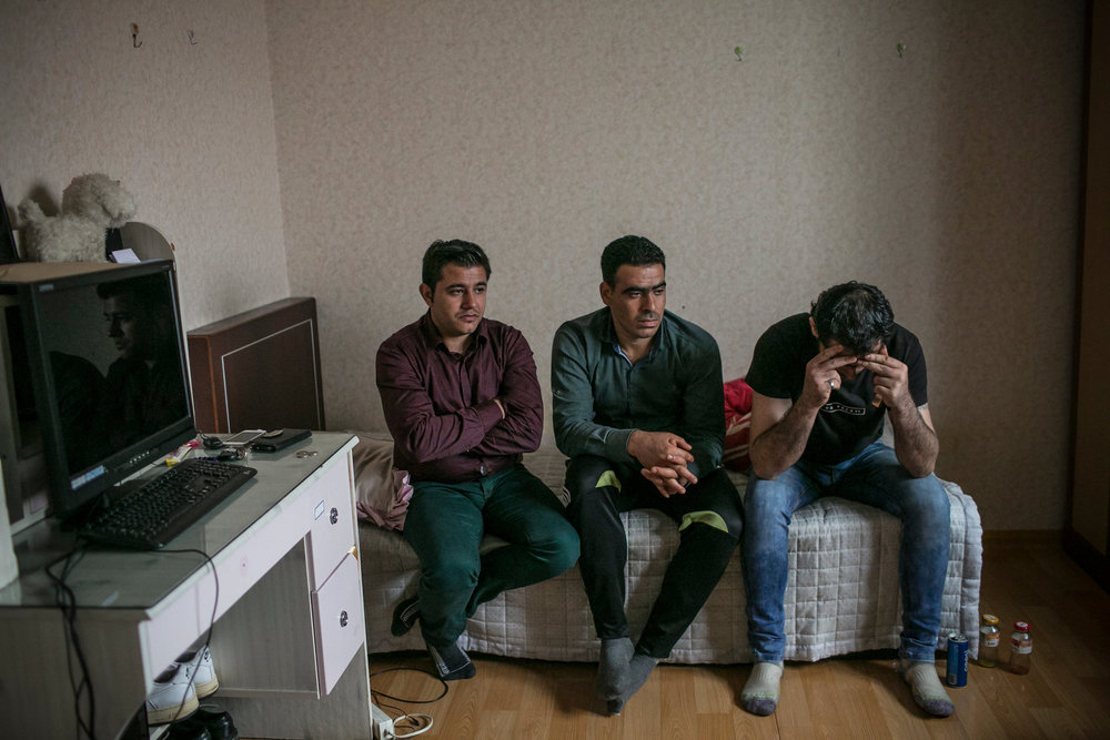 Ahmad Barro, left, Ahmad al-Othman and Ahmad Khalifa last month in Yangju, South Korea. The men, all from Syria, expressed frustration as they talked about family members left in Aleppo. Credit - Jean Chung for The New York Times