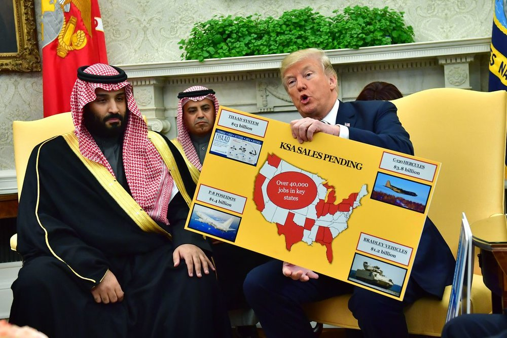 President Donald Trump holds up a chart of military hardware sales as he meets with Crown Prince Mohammed bin Salman of Saudi Arabia at the White House on March 20, 2018. Kevin Dietsch-Pool/Getty Images
