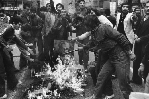 Protesters burned photos of the Shah.  | Source