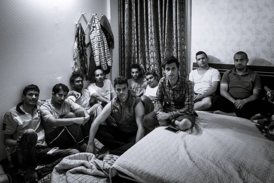 Mohammed with some other Yemen refugees - often they shared a room with up to 10 other people due to lack of money and support.