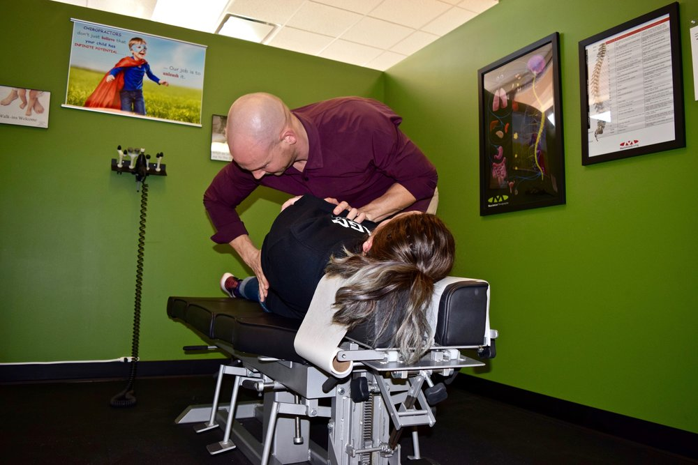 Max Chiro Dr Tim Lower Back Adjust Evelyn .jpg