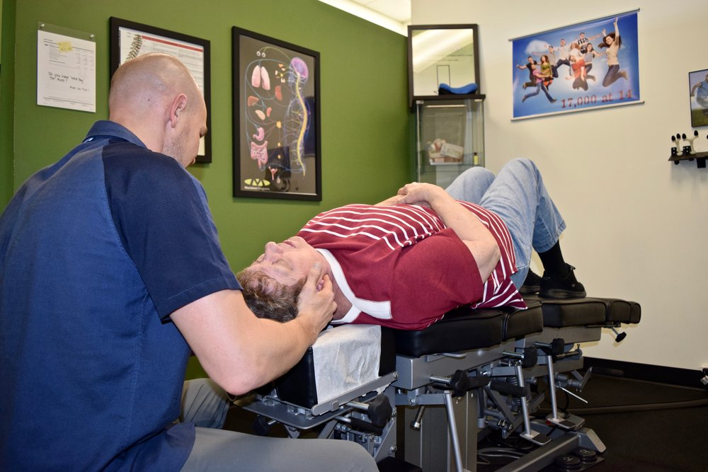 Max Chiro Dr Tim Patient Neck Adjust .jpg