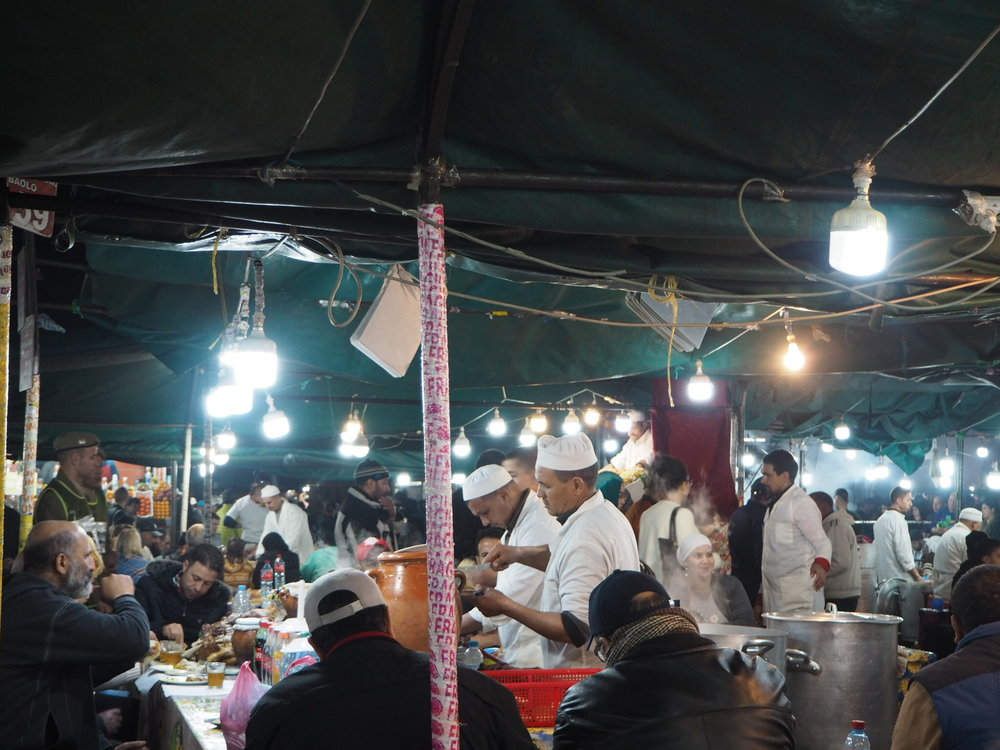 inside the night food market at jemaa el-fna - harira soup at stall 75 was delicious, for the most popular seafood head to stall 14