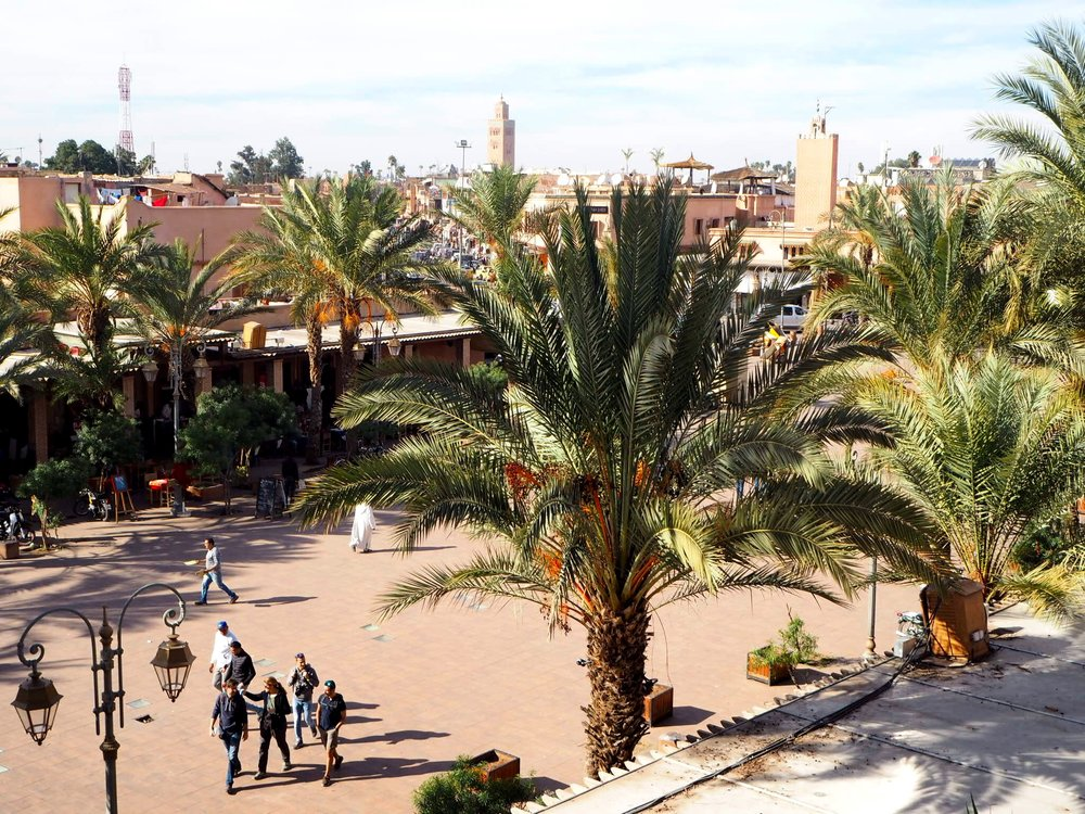 view from place des ferblantiers in the mellah (jewish quarter) with koutoubia mosque, the city's highest structure, in the background