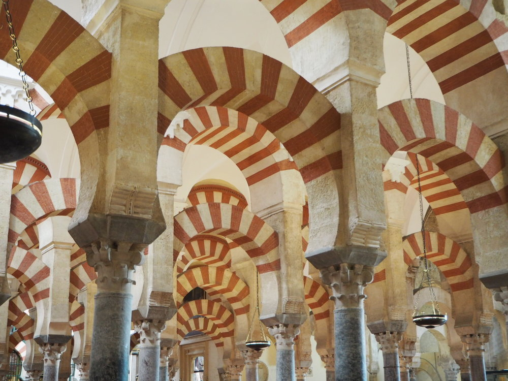 the 856 columns seem like they go on and on, once said to look like rows of palm trees in the oases of Syria. the architecture of the mezquita may have taken inspiration from both the great mosque of Damascus and the dome of the rock in Jerusalem.