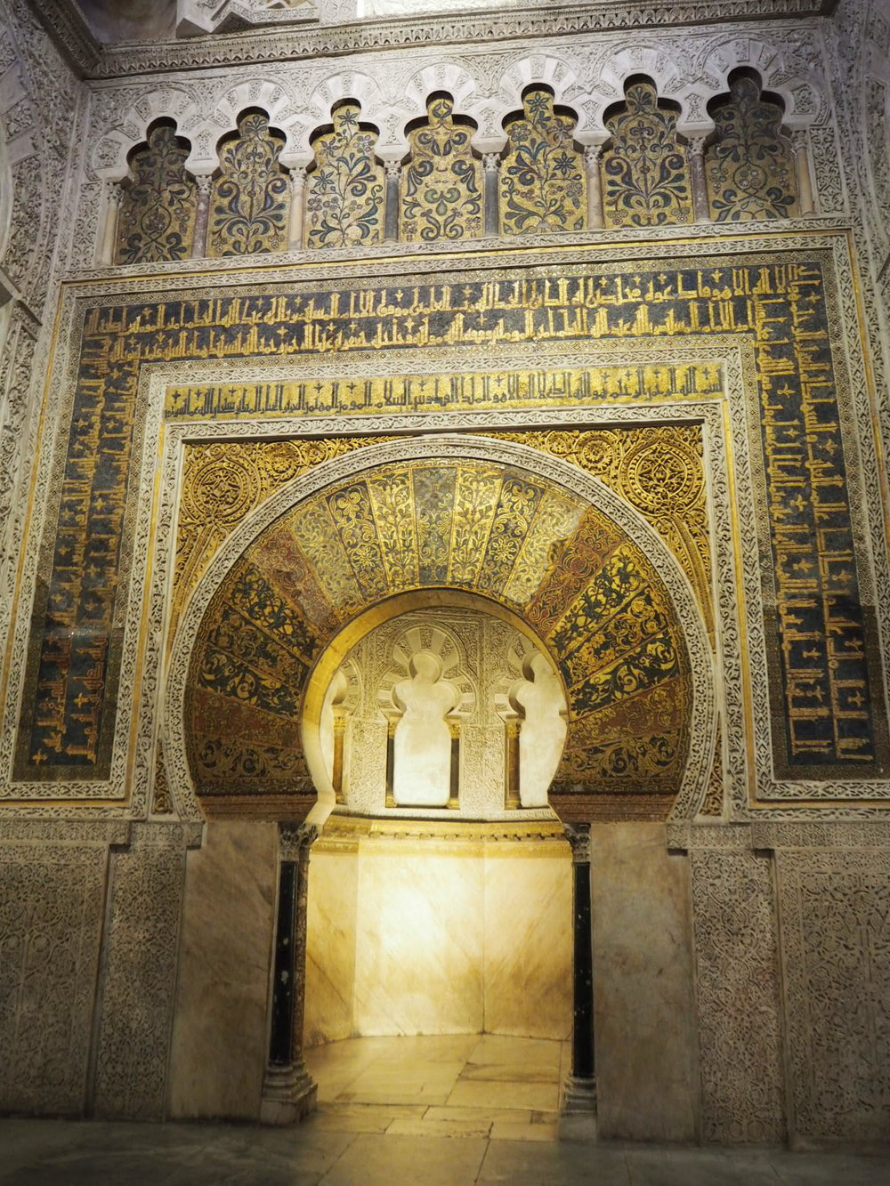 the mihrab, indicating the direction of mecca. most of the interior walls of the mezquita now play host to one of its 35 chapels.