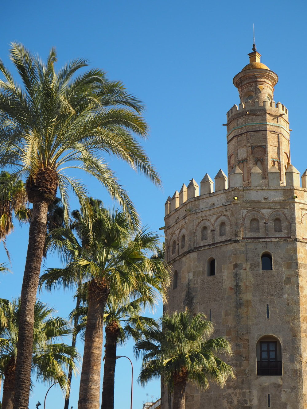 torre del oro (the tower of gold) was built by the Almohad caliphate in the 13th century.