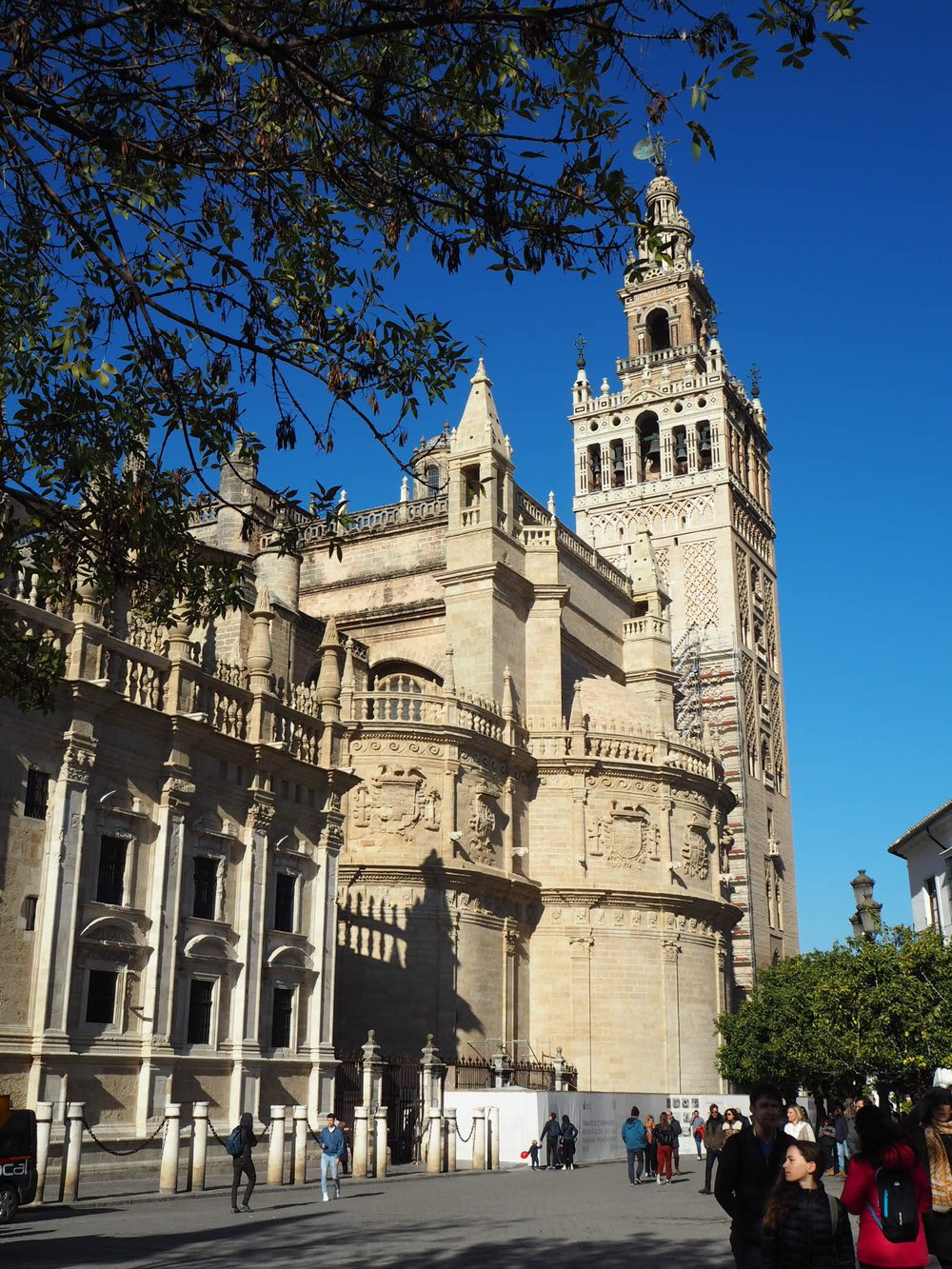 la giralda, the bell tower of the expansive seville cathedral, was originally built as the minaret of the great mosque of seville - catholics added the pointy renaissance-style top to the tower after the Reconquista.