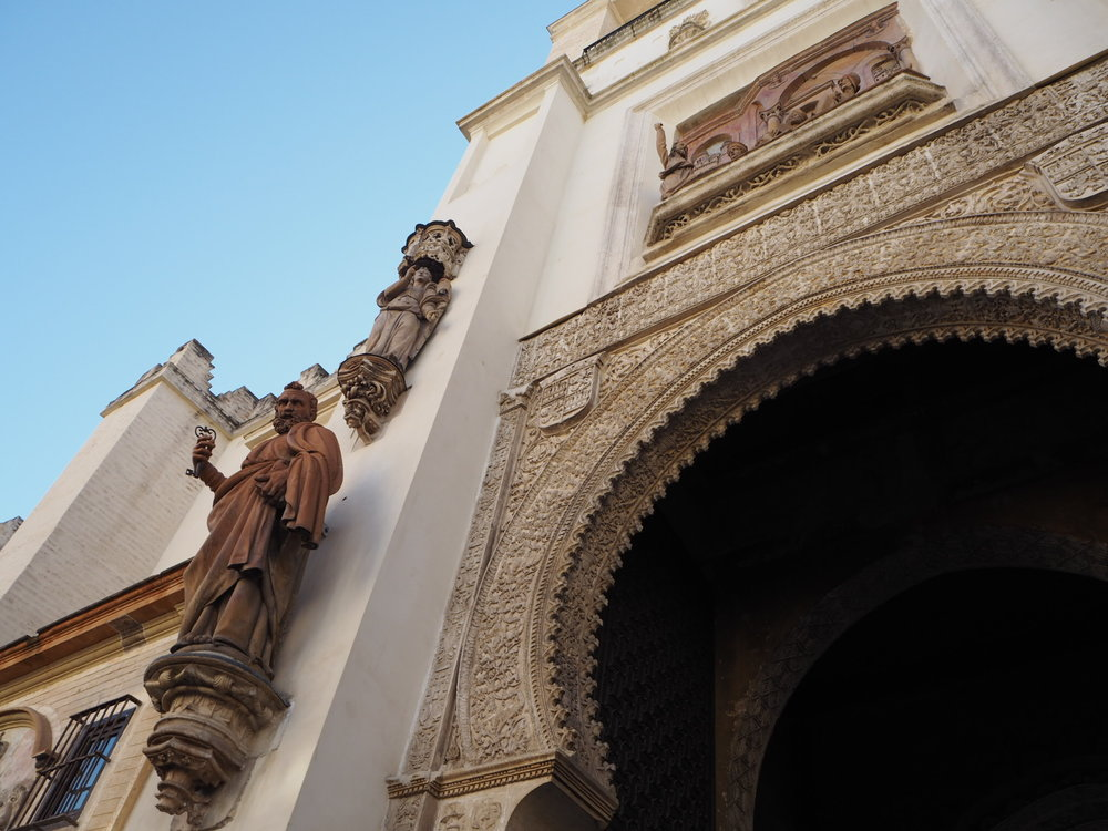 christian and muslim details at Puerta del Perdón, door of forgiveness, which used to be part of the mosque and is now one of seville cathedral's 15 doors.