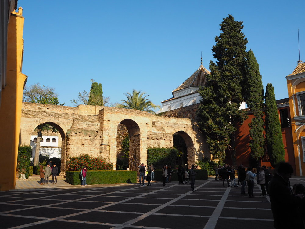 the alcazar of seville, taking its name from the Arabic al-qsar, 'the castle', is built on the site of a former basilica, destroyed by the moors in 712 to make way for a military fortress and palace. after the Reconquista and an earthquake that destroyed most of the original fortress, only this wall in the patio de la Monteria remains as a reminder of the Muslim period.