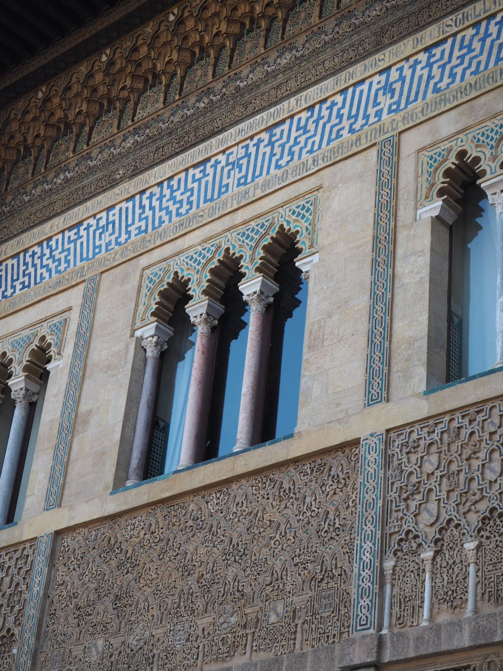 Spanish rulers liked the style of the former residents so much that they employed muslim artisans to build a palace on the site of the historic Alcazar, the mix of Islamic and western style, displayed above, now known as mudejar (from Arabic 'allowed to remain')