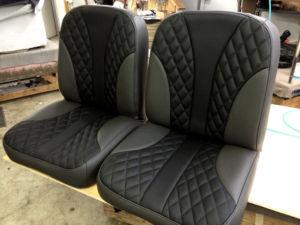 Custom black leather diamond stitch bucket seats with black and grey leather outlines.