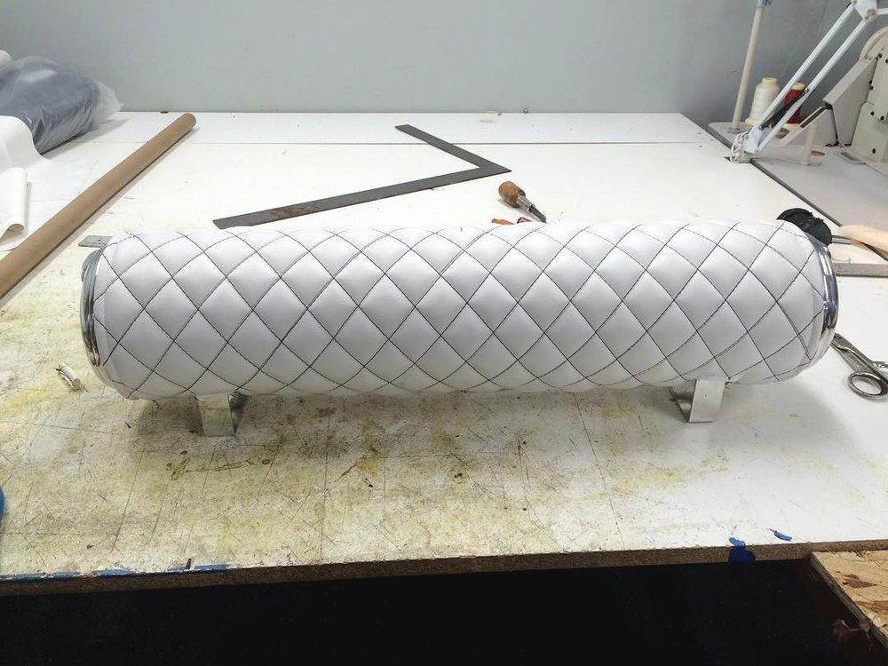 Custom white leather tank wrap with diamond stitching.