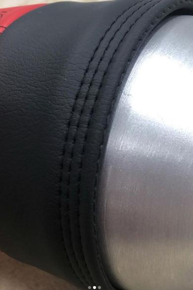 Custom tank wrap, black leather stitch detail.