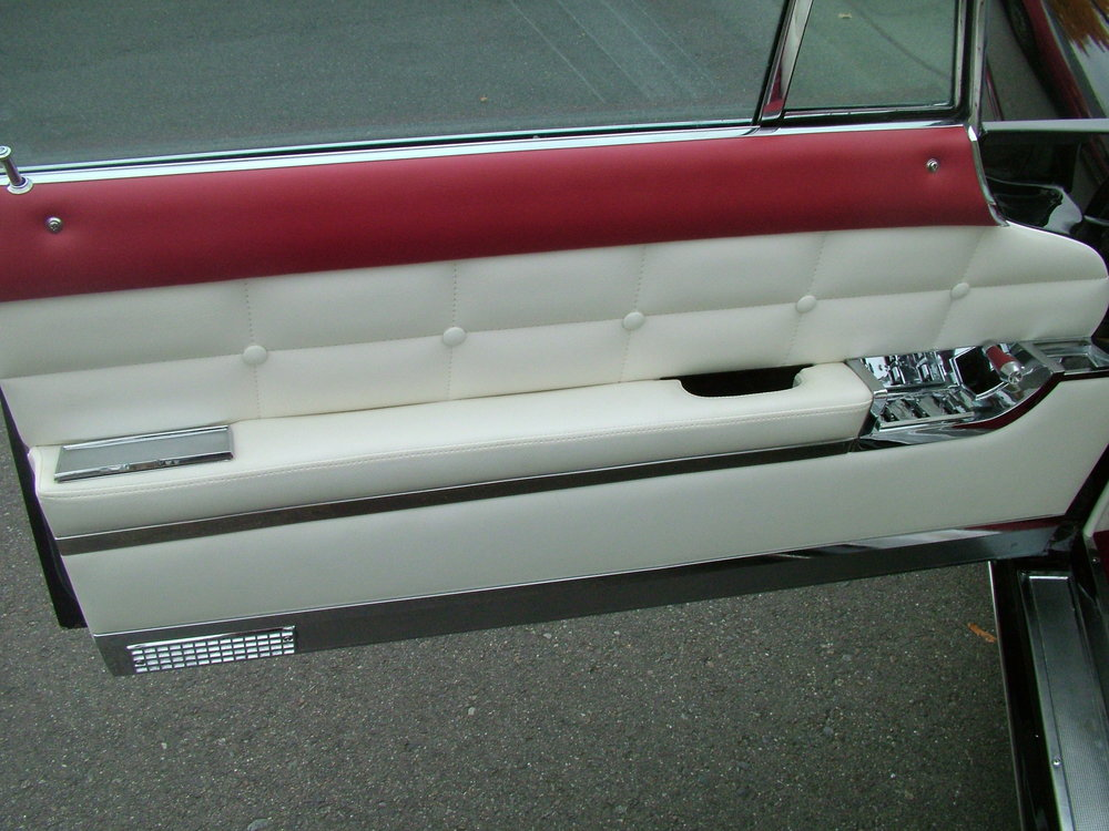 Lincoln - Custom door panels. Red and white leather.