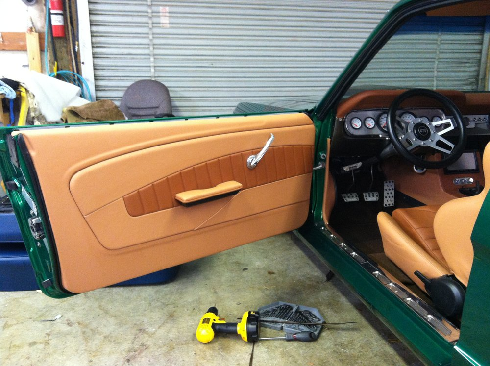 Mustang - Custom door panel - Tan leather with a tan leather stitched accent, matching seats, dash and interior side panels.