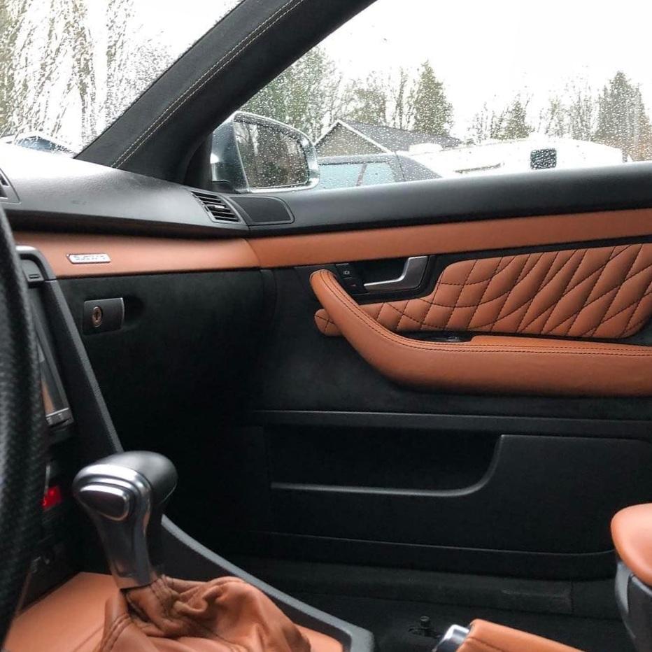 Audi Custom door panel, tank leather with stretched diamond stitching, matching dash, console, and shift boot.