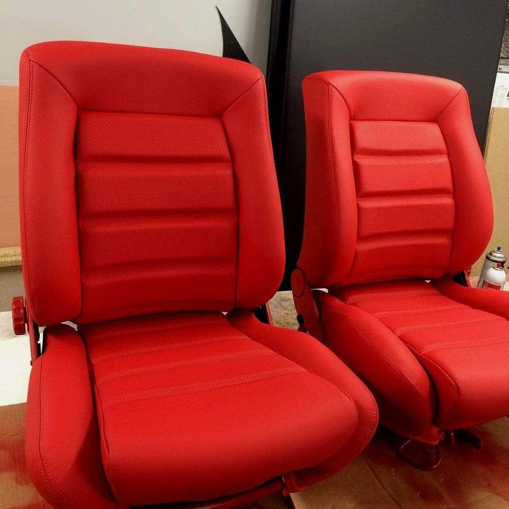 Custom red leather bucket seats