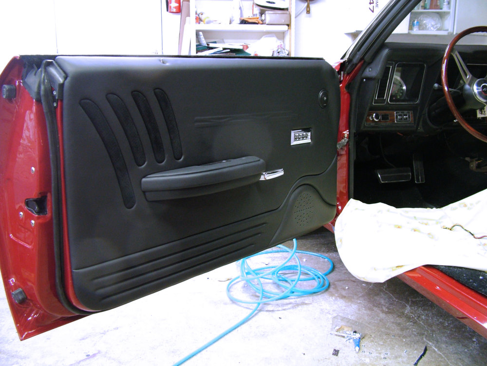69 Camaro full custom interior with black leather wrapped door panels.