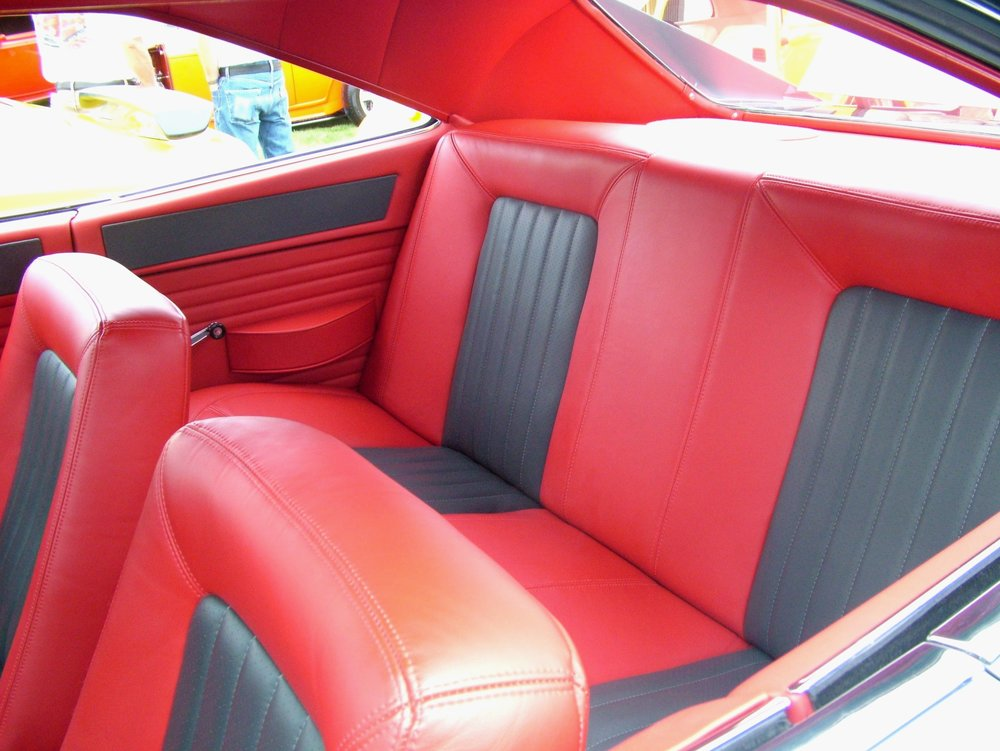 Charger- full custom interior with red and grey leather seats, red leather headliner and side panels, and matching door panels.