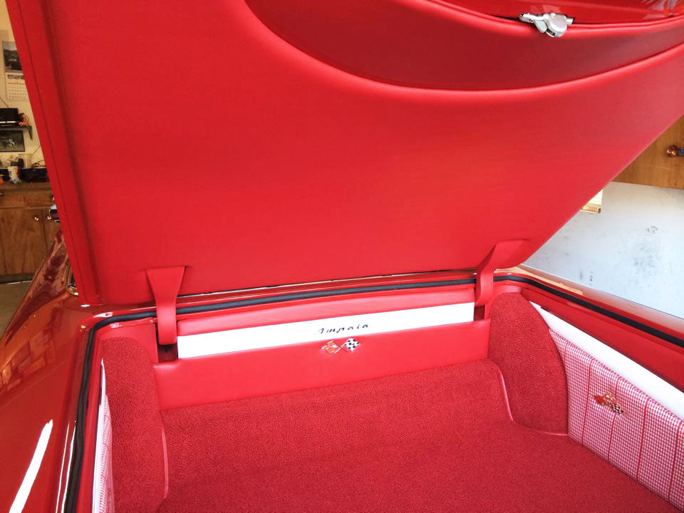 Impala complete interior restoration. Red and white trunk carpet and lining.
