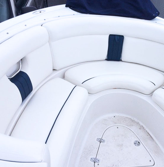 Custom speed boat upholstery. white and navy leather wrapped seats.