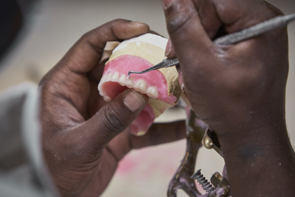 Aaron Taylor is making the final touches to a beautifully designed denture.