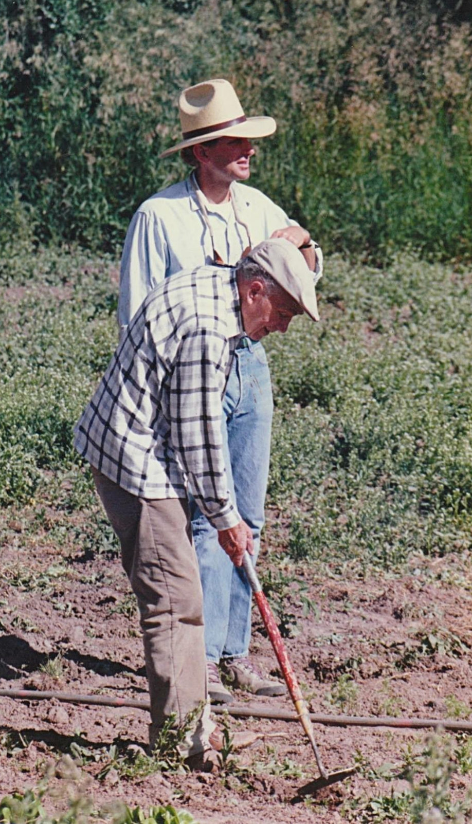 Founder Lowell Bennion working in the ranch's garden with his successor, Steve Peterson.