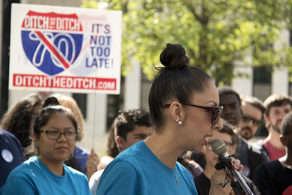"Candi CdeBaca. ""Ditch the Ditch"" activists announce a new lawsuit challenging the I-70 expansion outside the Alfred A. Arraj United States Federal Courthouse, July 10, 2017. (Kevin J. Beaty/Denverite)