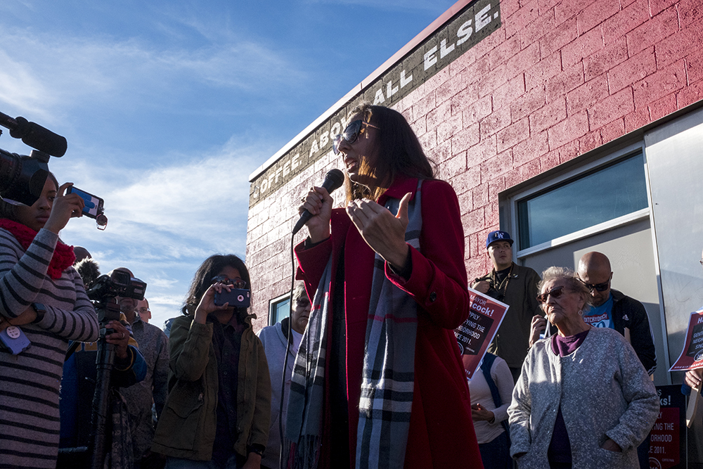 Candi CdeBaca speaks during a rally against Ink! Coffee in Five Points, Nov. 25, 2017. (Kevin J. Beaty/Denverite)