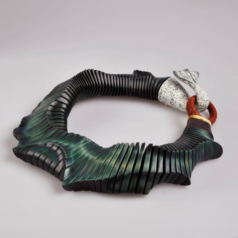 Neptun's Lantern, 2017  | Necklace | Stained maple wood, African blackwood, Japanese oak, buffalo horn, brass discs, polyester cord  Photo credit: Guri Dahl