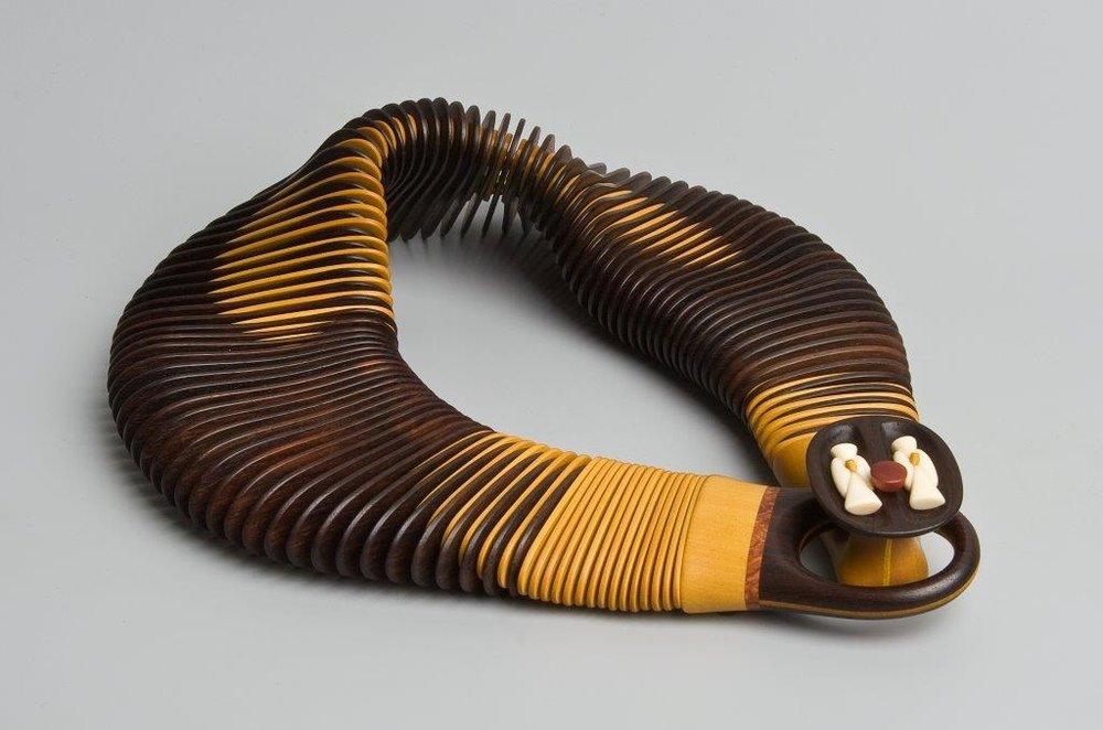 Månemenn, 2008.  Necklace | Palisander, amarello, amboina, whales' tooth, brass discs, polyester cord  Photo credit Guri Dahl