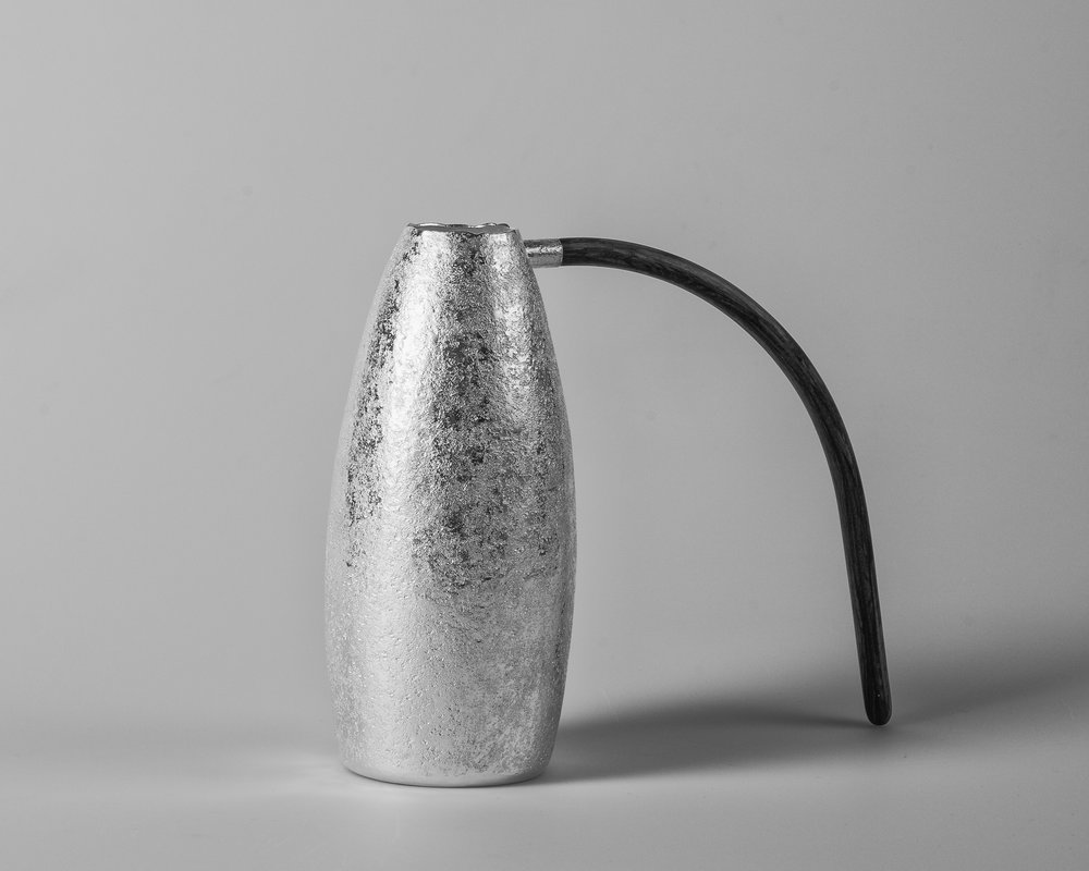 The importance of water I (Vessel), 2018    Forged silver 925 S. 367 g. Laminated wood. H. 17 x W. 21 cm.  Photo credit: Christian Tviberg