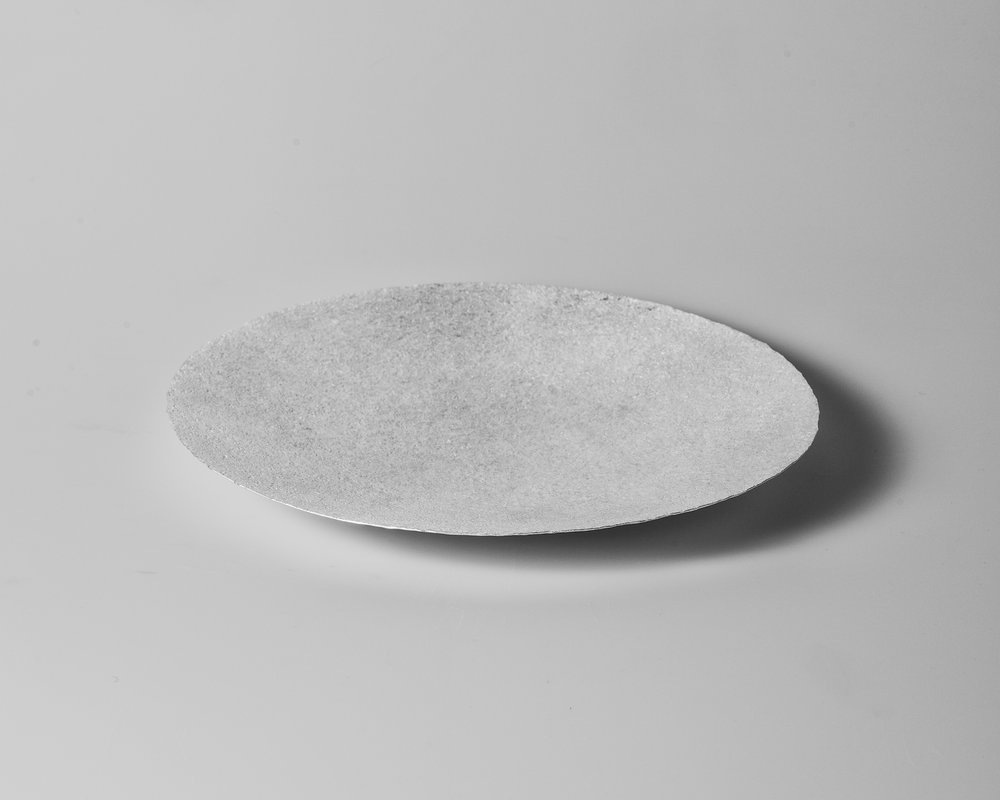 The importance of water IV (Dish), 2018    Forged silver. 925 S. 576 g. H. 3 x W. 29 cm.  Photo credit: Christian Tviberg