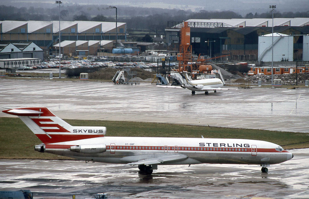 It's another one of those quick snaps from the office window in the old Tower Block. Sterling B727-200 OY-SBF is the subject matter on this occasion.Peter H- March 1986.