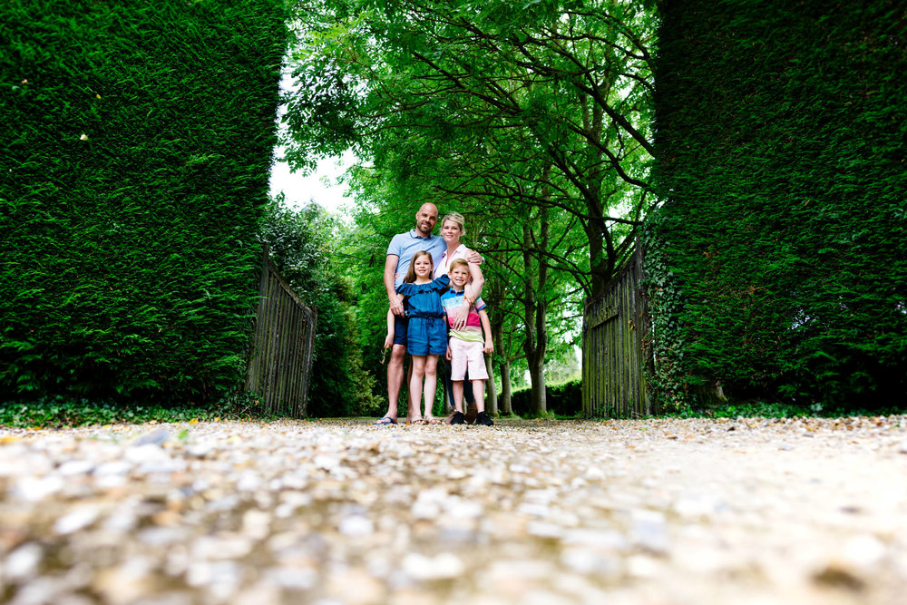 Family stood in between lush green gateway at Arrow Valley Park
