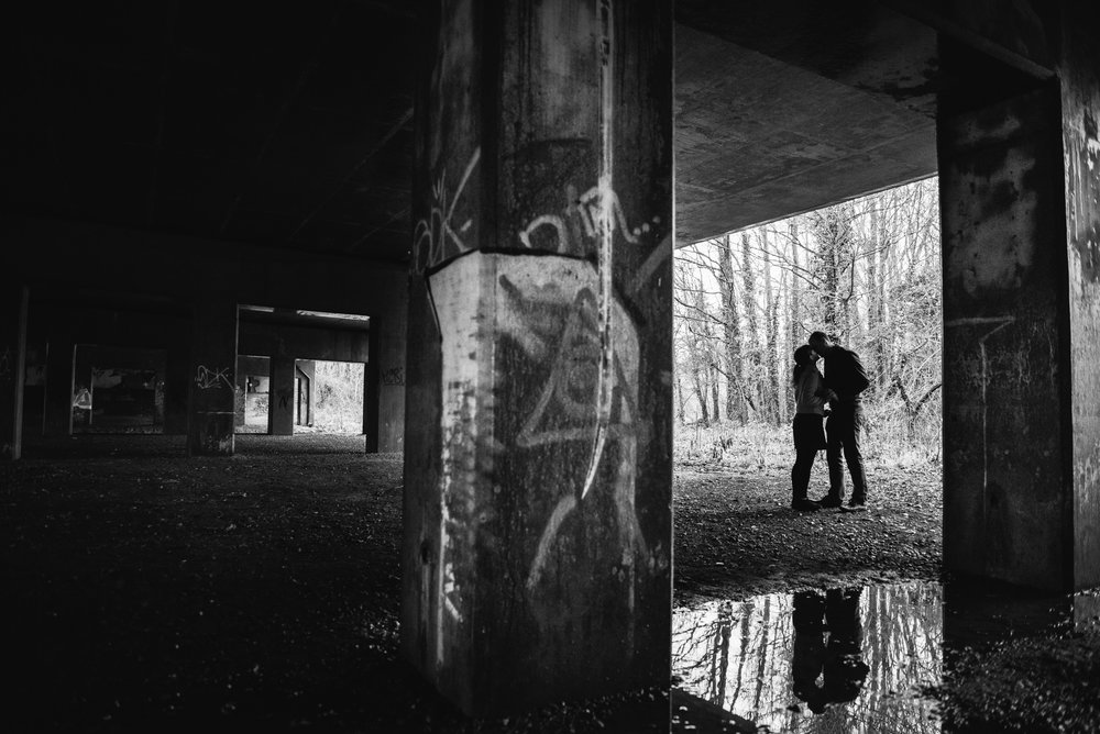 Pre-Wedding shoot silhouetted couple portrait under an urban flyover