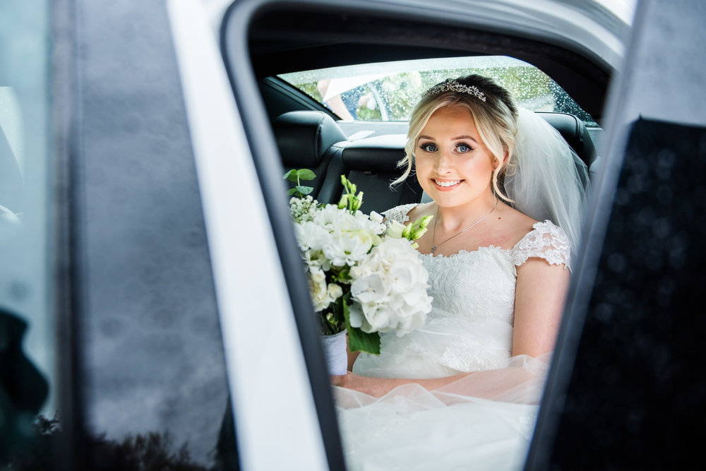 Beautiful bride sat in Wedding car ready to get married