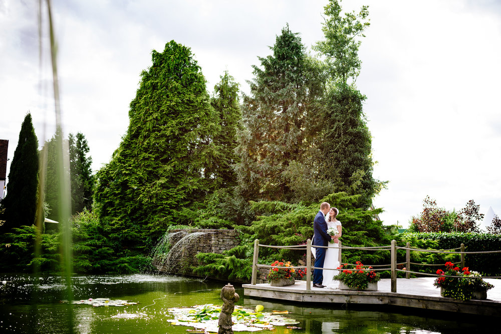 Newlywed couple portrait in beautiful gardens at Red House Barn Worcs