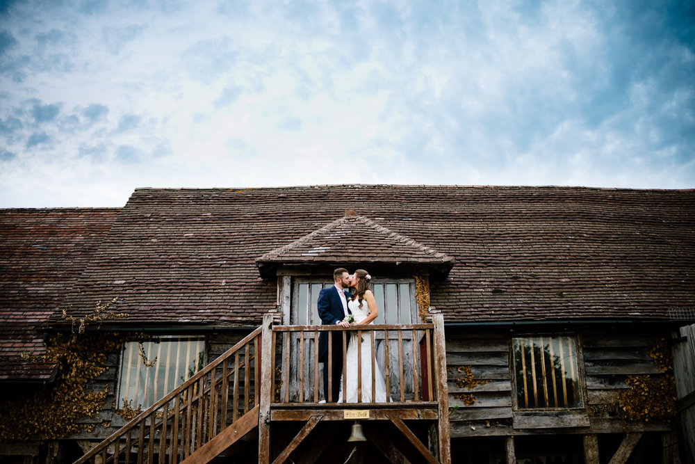 Couple portrait on an old wooden balcony at The Jinney Ring Worcs