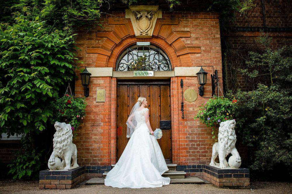 Bridal Portrait stood in the front doorway of Ardencote Manor Warks