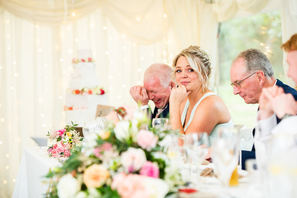 Bridesmaid with tears in her eyes during Wedding speeches